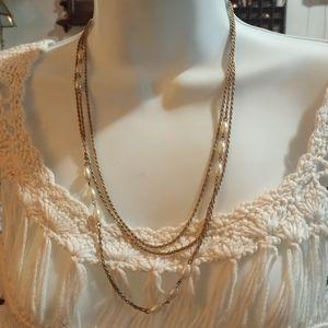 Triple strand faux pearls